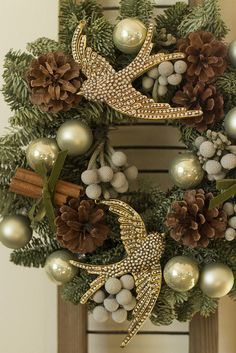 This lovely wreath, in greens and creams with the its 2 gold 'beaded' doves would be noticed and remarked upon anywhere it was displayed. The natural pinecones and cinnamon sticks add a degree of warmth and reference to the sights and smells of the holiday season..