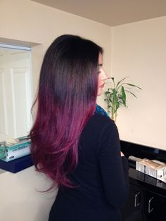 Purple ombre hair - for this color, several inches of hair are lightened for an ombre effect, and then dyed with purple to contrast with the natural brown hair...