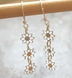 Items similar to Sterling Silver 3 Cut Out Daisy Dangle Earrings on Etsy Long Silver Earrings, Sterling Silver Earrings, Dangle Earrings, Gold Necklace, Daisy, Dangles, Unique Jewelry, Handmade Gifts, Kid Craft Gifts