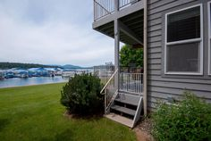 Waterfront Condo overlooking Lake Pend Oreille and the beautiful Selkirk Mountains. Perfect ground floor living in this two bedroom two bathroom, 1125 sqft. home featuring a bright open floor plan, hard wood floors, cozy fireplace, central heat & AC, one car attached garage, fenced patio ready for a hot tub & a covered deck to take in the spectacular sunsets. Offered completely furnished and ready for year round living or this could be your perfect lake getaway!