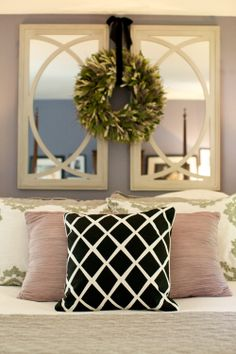 love the mirrors and wreath above the bed