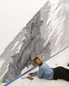 Katy Ann Gilmore painting her mural at Facebook HQ