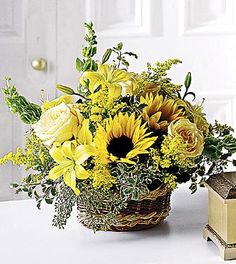 FTD Flowing Garden Basket  Price: 89.90    A beautiful bouquet to say you'll never forget them. Yellow roses, lilies and sunflowers are sweetly arranged with eucalyptus and other greens in a basket. Approx. 18H x 18W