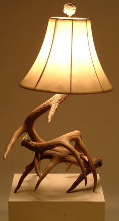 Description: Whitetail or mule deer antler table lamps are available in a variety of sizes ranging from large (18 to 24 inches high) to small (12 to 16 inches high). Most are created with three to four large to medium deer antlers. These lamps come with the appropriate size harp, a 3-way socket and antler burr finial. Shade is not included.  Price: $155 to $225