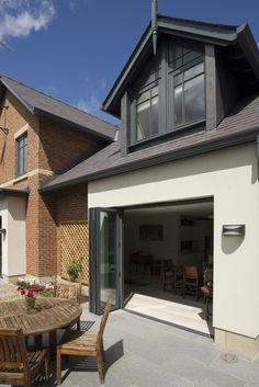 pitched roof extension with clean white render Loft Dormer, Dormer Loft Conversion, Glass Extension, Roof Extension, Extension Ideas, Grey Windows, Dormer Windows, Rendered Houses, Fibreglass Roof