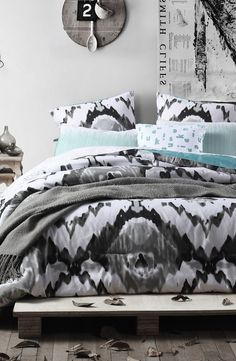 The mix of geometric and watercolor prints on this bedding lends a boho-chic vibe to any stylish bedroom.