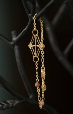 "Golden diamond pendant connects to gold chain and hand wired rhodonite gemstones. Rhodonite is known to help calm the nervous system, bring balance and is also known as a ""rescue stone"". #handcrafted"