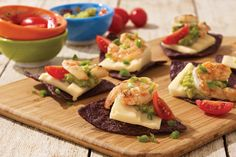 Want your party to be a success from the get-go? Serve these appetizers made with lime-kissed shrimp, sharp cheddar and creamy guacamole.