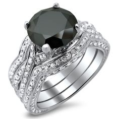 <li>Round-cut black diamond bridal ring set</li><li>14k white gold jewelry</li><li><a href='http://www.overstock.com/downloads/pdf/2010_RingSizing.pdf'><span class='links'>Click here for ring sizing guide</span></a></li>