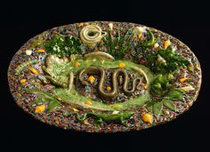 After Bernard Palissy  (French; b. St.-Avit, France, 1509-d. Paris, 1590)  Rustic Plate with Snakes, Lizards, and Frog  19th century  lead-glazed earthenware  3 x 17 x 22½ in. (7.6 x 43.2 x 57.2 cm)