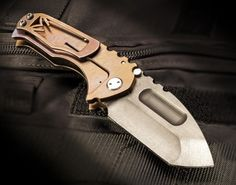Praetorian Ti folder (custom anodized) by Medford Knife & Tool (www.medfordknife.com)