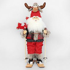 The Moose Hat Ski Santa from Karen Didion Originals brings the joy of Christmas into your home. The quality of this figurine is unmatched with its hand-painted face, glass inset eyes, real mohair beard, unique fabric, and detailed accessories.