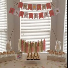 1st birthday decorations for a pink and gold candy buffet.  Pink and Gold Banner.