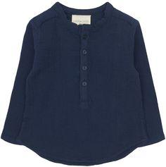 Louis Louise Grand Pere Baby Shirt: Navy cotton crepe baby shirt by Louis Louise. Button-fastening at front. Split side seams. Curved hem. Stitched designer logo at hem.