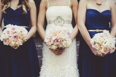 Pretty whites and blush tones for bridal bouquet and bridesmaids.  Could use more green.