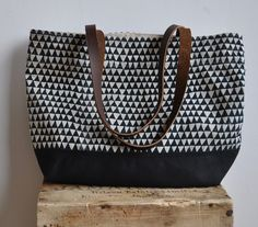 BOOKHOU at HOME, triangle tote bag, screen printed linen canvas, upcycled leather handles.