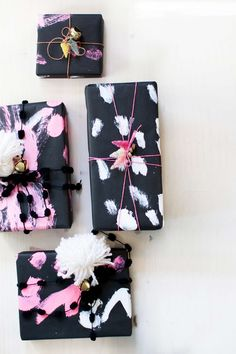 use pastel paint on black paper to make some painterly gift wrap