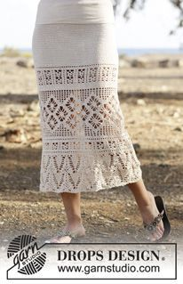 """Summer Escape by DROPS Design. Crochet DROPS skirt with double crochet, lace pattern, worked top down in """"Safran"""". Free Pattern."""