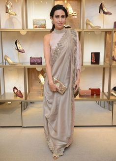 Karisma Kapoor is quite a shape-shifter when it comes to her wardrobe choices. Check out her best looks, from draped sarees to kurtas and gowns, from Saree Wearing Styles, Saree Styles, Stylish Sarees, Stylish Dresses, Indian Wedding Outfits, Indian Outfits, Indie Mode, Indian Gowns Dresses, Dress Indian Style