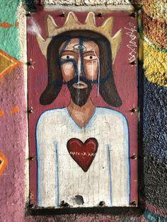 Interesting contrast of gang graffiti over historical street art mural (Chicano Park Barrio Logan San Diego)
