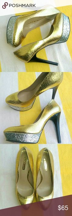 🆕BCBGeneration Heels Model: BG-Made B - All Man Made Material - Gold, Silver, & Black -Platform is Silver -Heels are black -New with Tags BCBGeneration Shoes Heels