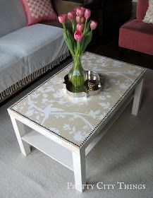 Coffee table redo: Wallpaper or heavy wrapping paper covered table with nail head trim!!! THIS IS PERFECT