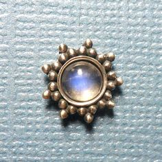 Large Sterling Silver Blue Moonstone Sun by Starseedcharms on Etsy, $28.00