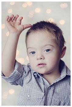 My sweet boy #downsyndrome #twinklelights #childphotography