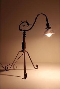 Another Mans Treasure Lamp-Anthropologie.com - A perfect reading lamp.