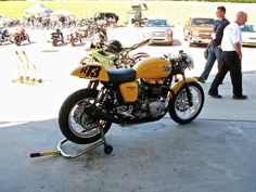 The Triumph Thruxton: 10 years down the road - RevZilla Vintage Cafe, Vintage Bikes, Triumph Thruxton 900, Fifth Gear, Triumph Cafe Racer, Bone Stock, Cafe Racer Build, Heavy Metal Music, Yellow Painting
