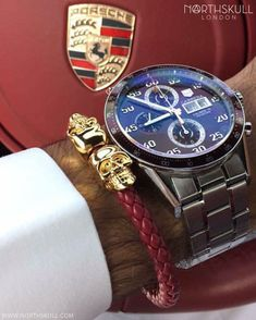 Fan Instagram Pic ! | While behind the wheel of his Porsche @abdulwahab_mansouri is ready to go with his Tag Heuer Calibre 16 Day-Date Watch nicely paired with our luxurious Red Nappa Leather & Gold Twin Skull Bracelet. Great combo ! | Available now at Northskull.com | For a chance to get featured post a cool photo of your Northskull jewelry with the tag #Northskullfanpic on Instagram