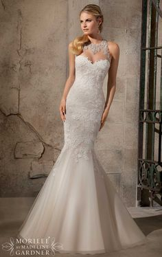 A gorgeous but expensive (1,500) Mori Lee 1,200 on house of brides