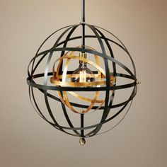 Multi-tone Metal Strap Pendant Suitable for modern, contemporary or traditional decor, this oil-rubbed Bronze metal strap pendant incorporates accents in French gold and antique brass. Orb Pendant Light, Orb Light, Large Pendant Lighting, Brass Pendant, Chandelier Lighting, Entry Lighting, Round Chandelier, Gold Pendants, Lighting Ideas