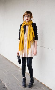 pink dress, mustard scarf, leather leggings, black clutch, ankle boots, and long pendant