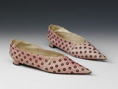 "Shoes: ca. 1800, English, stencilled leather. ""This style of heeled shoe, made of pastel coloured kid leather with painted or stencilled patterns, with an exaggerated pointed toe, was popular in the latter years of the 18th century. It was much simpler than previous women's styles which had tended to be made of leather, have a pronounced heel. They had often been made of fabric. In 1801 the Lady's Magazine which illustrated just such spotted kid shoes."""