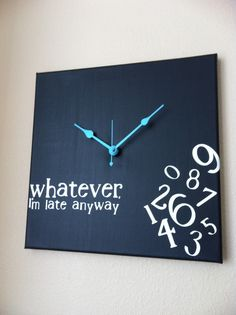 "Handmade clock, so no two are the same! This is a 12x12 canvas, painted black with white vinyl lettering that reads ""whatever, I'm late anyway"" Hands are a turquoise colored blue."