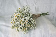 Small flower girl bouquet made simply with gypsophila and tanacetum. Finished with burlap and twine