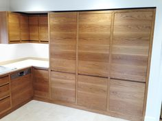 This unique design has been lacquered with our water and stain resistant treatment. Not only does it promote the natural glow of White Oak, it ensures longevity. Hidden within the tall, full-length cupboards are neat pull-out shelves on soft close runners.