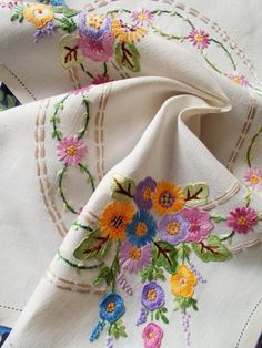 Beautiful hand embroidered linen tray cloth - used I think this is from the 50s but I am not absolutely sure Beautifully done embroidery on a ivory colour linen in such gorgeous colours - lavender, lilac, golden yellow, grass green, water green, mushroom, cream, sienna brown, pale mauve, dusty pink, sky blue and soft orange . The colour combination and craftsmanship are lovely. Dimensions - approx. 19 x 13 Condition - This has been occasionally used over the years but is in beautiful con...