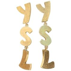 Preowned 1990s Yves Saint Laurent Stunning Ysl Gilded Metal Earrings ($1,443) ❤ liked on Polyvore featuring jewelry, earrings, beige, earring jewelry, pre owned jewelry, hammered metal jewelry, metal earrings and hammered metal earrings