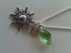 Peridot Swarovski Crystal Pewter Sun Charm Sm Sterling Silver Lotus Flower and Chain.$29.99 www.etsy.com/shop/essencebay