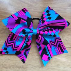 A personal favorite from my Etsy shop https://www.etsy.com/listing/223634080/neon-tribal-aztec-cheer-bow-purple
