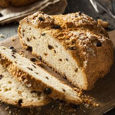 Irish soda bread sliced and ready to eat. Looking rustic, Irish soda bread sits on a table and is cut apart and ready to be enjoyed. Irish Bread, Irish Soda Bread Recipe, Raisin Recipes, Bread Recipes, Cooking Recipes, Copycat Recipes, No Yeast Bread, Bread Baking, Baking Soda