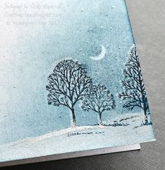 Her website has full details on how to create this card. In brief: trees versamarked & clear embossed, snow & the moon masked off and the sky sponged in before stamping the trees again, this time in StazOn ink, using a stamp-a-majig to offset them. Add texture to the snow with white embossing powder & added tiny touches of Dazzling Diamonds glitter with two-way glue pen.