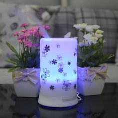 Signstek 100 ML White with Chrysanthemum Pattern Ultrasonic Aroma Diffuser Humidifier with 4 Timer Settings and 7 Color Changes. This is the other diffuser I bought for my other daughter's room. Small but works fine. I like the timer function and the kids like the lights.
