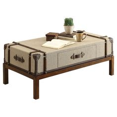 Pairing jetsetting sophistication with Old World style, this trunk-inspired coffee table features faux leather accents and 1 drawer with nautical-print linin...