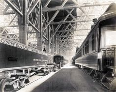 View of the railway exhibit including the Chapel Railroad car in the Palace of Transportation at the 1904 World's Fair.
