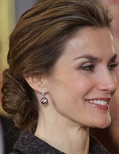 Doña Letizia wore her black star-burst drop earrings with diamond hoops.