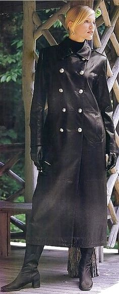 Blonde in long black leather button down military style trench coat
