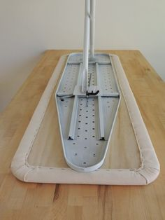 Step 12 - Secure (Screw) Ironing Board Base to Plywood Top DIY Tutorial